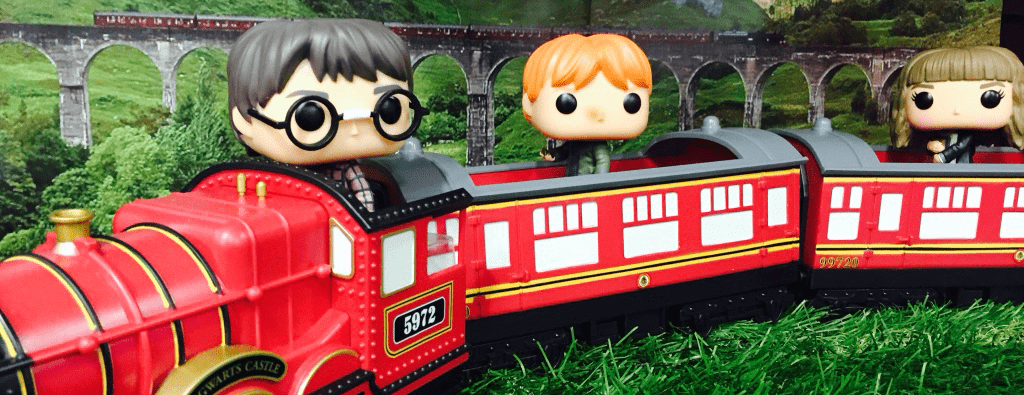 Harry Potter, Ron Weasley and Hermione Granger Pop! Vinyls riding the Hogwarts Express